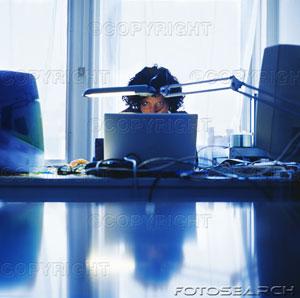 woman-sitting-at-desk-working-on-laptop-200161531-001.jpg